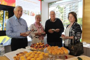 Some of our high tea attendees enjoying handmade tarts and scones